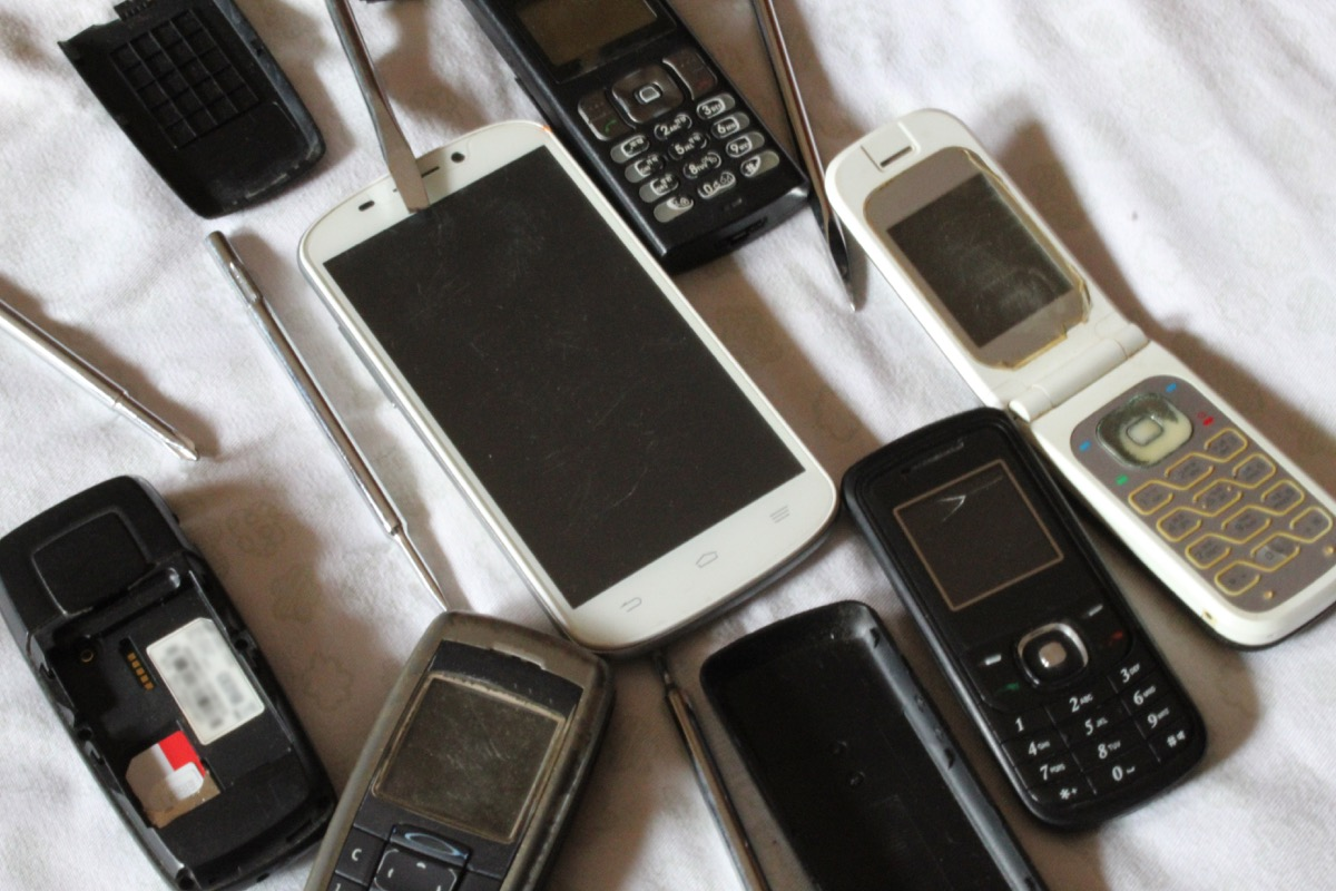 Old mobile phones all together being serviced or repaired.