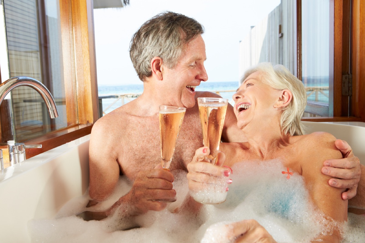 older couple in bubble bath, healthy sex after 40