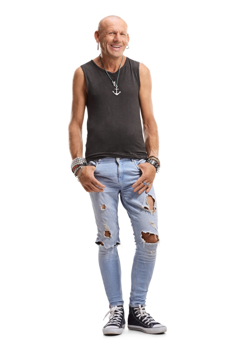 Older man in punk outfit ripped jeans