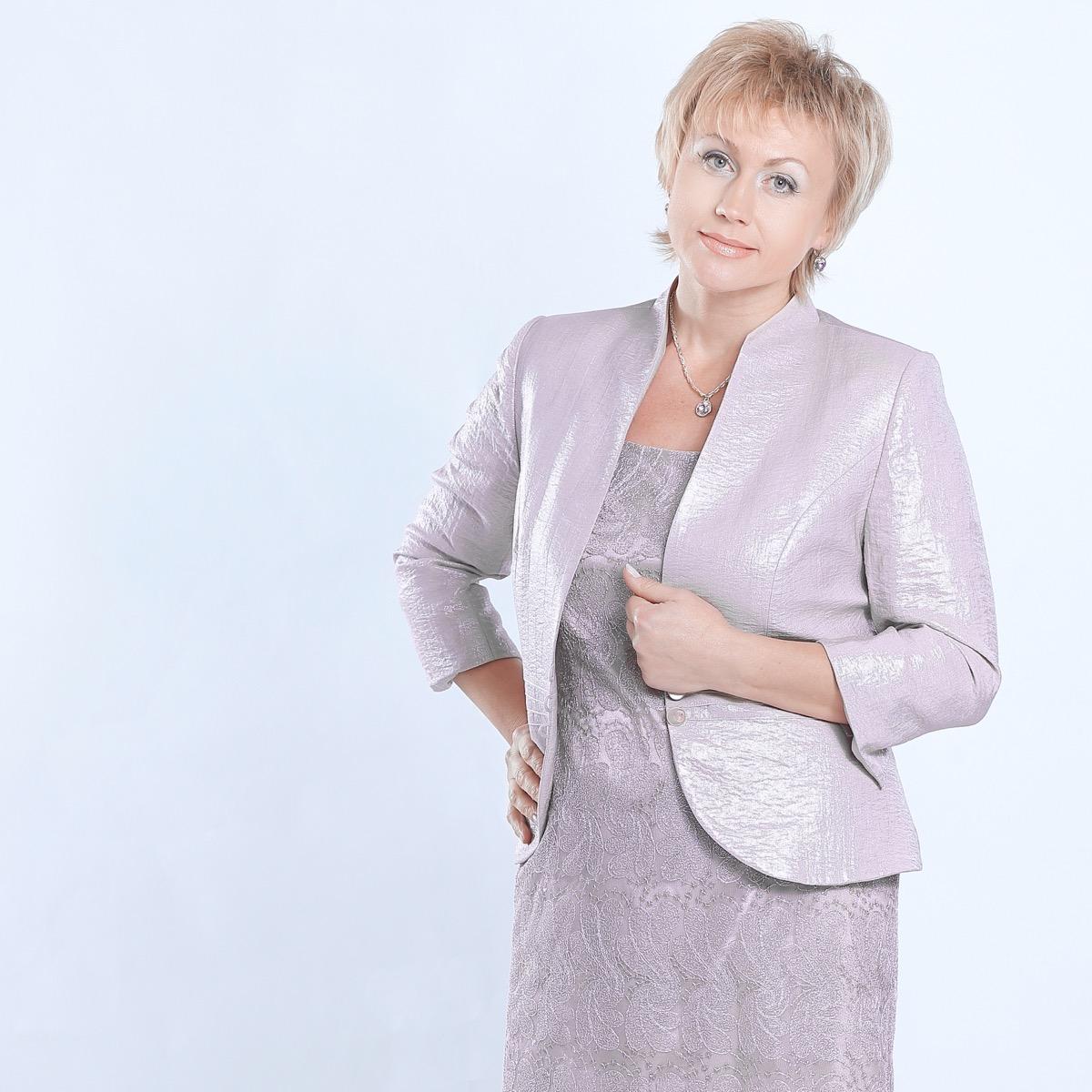Older woman wearing a purple dress and matching blazer