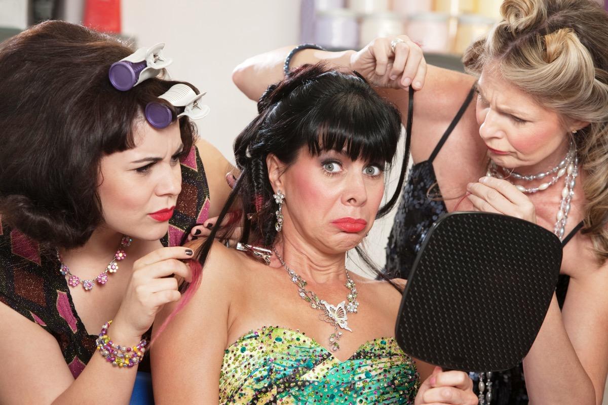 Older women friends doing hair