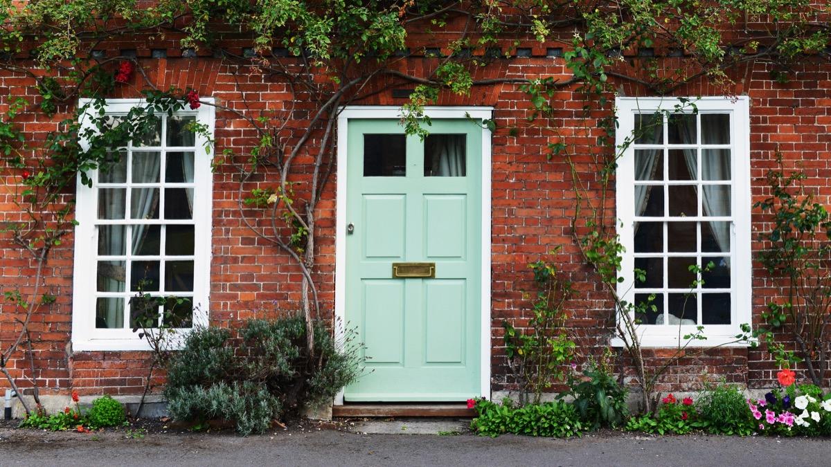 Mint painted door brick house