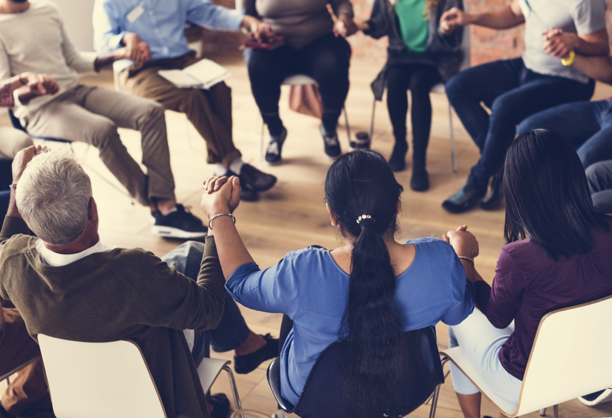 people involved in a support group exercises for mental health