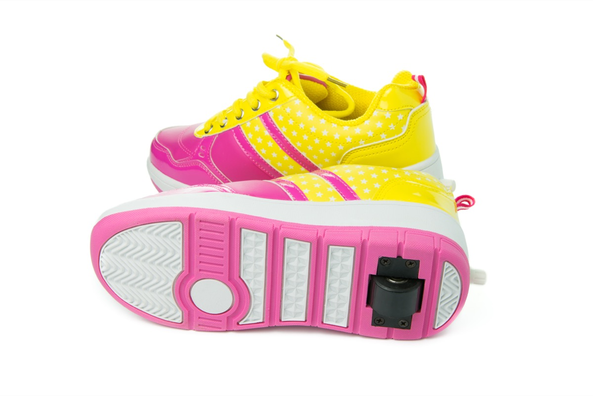 Pair of pink heelys on white background - Image