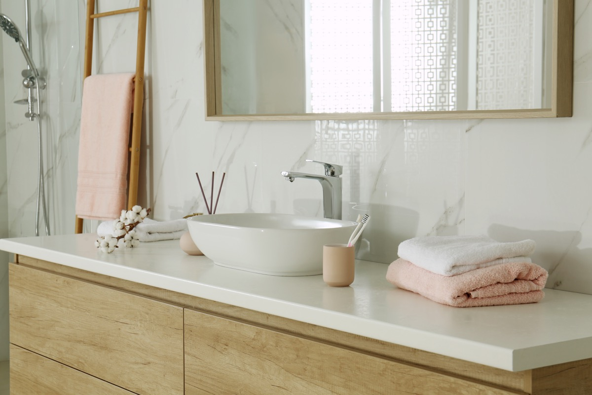 Pink accented bathroom decor