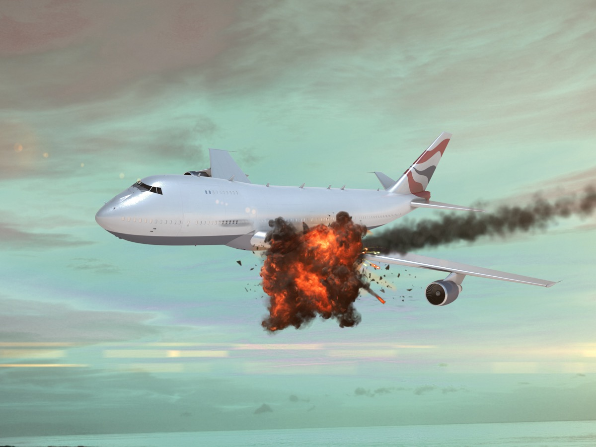 Airplane with an explosion in the sky