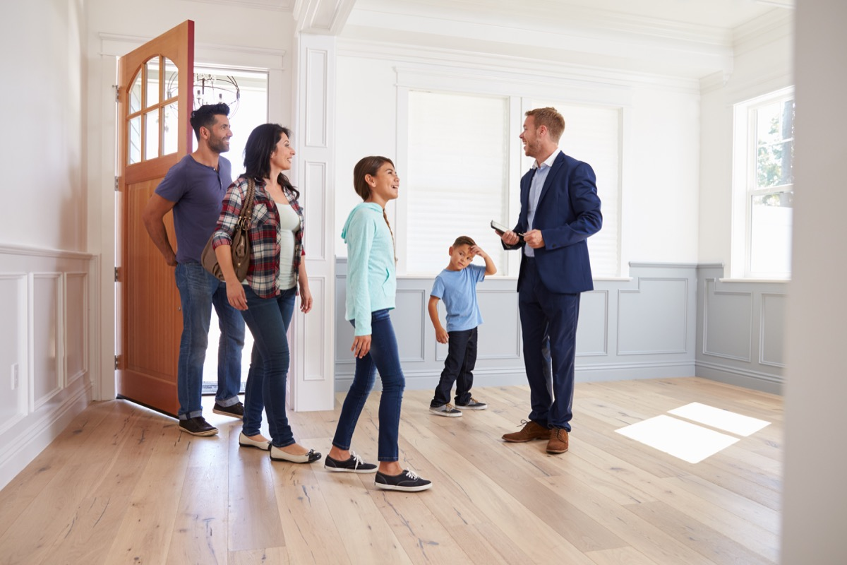 Real Estate Agent Showing a Family a House {Cons of Owning a Big House}