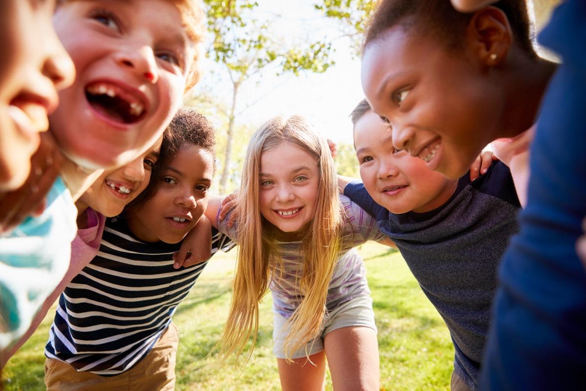school kids laughing in circle
