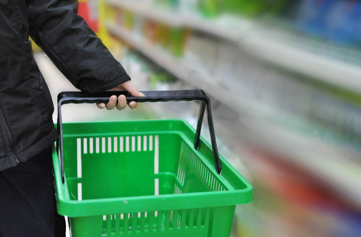 Woman Holding a Shopping Basket at the Store {Smart Shopping Habits}