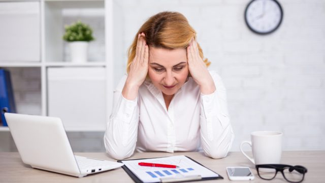 woman stressed by work