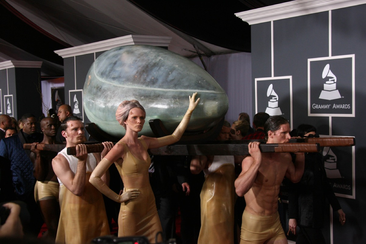 lady gaga inside an egg being carried into the grammy awards on the red carpet