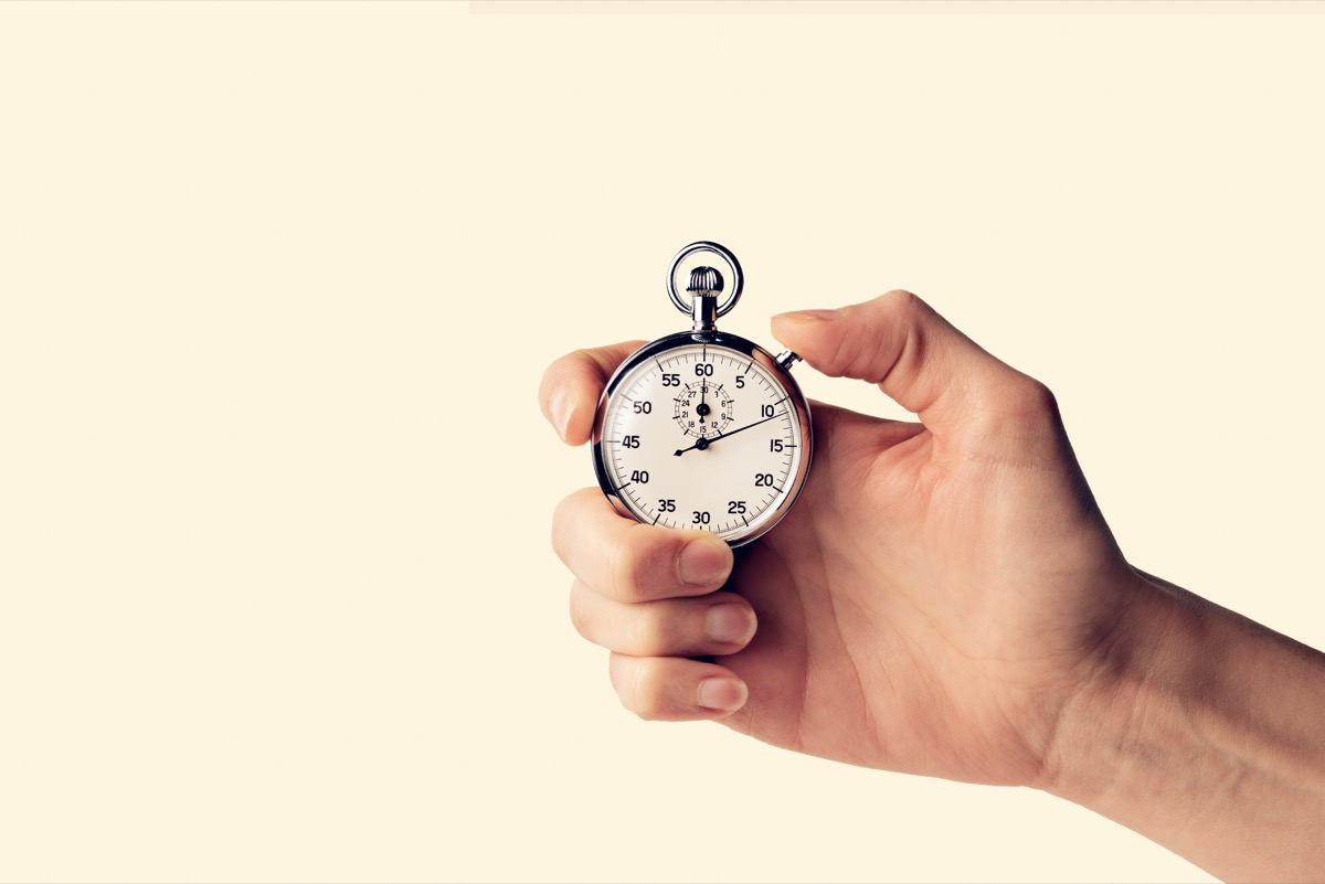 timer held in hand for seconds minutes hours