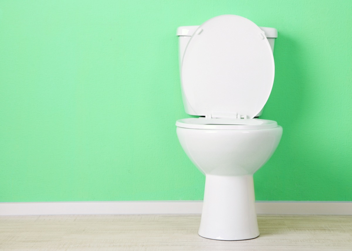 toilet against a sea green wall, diy hacks