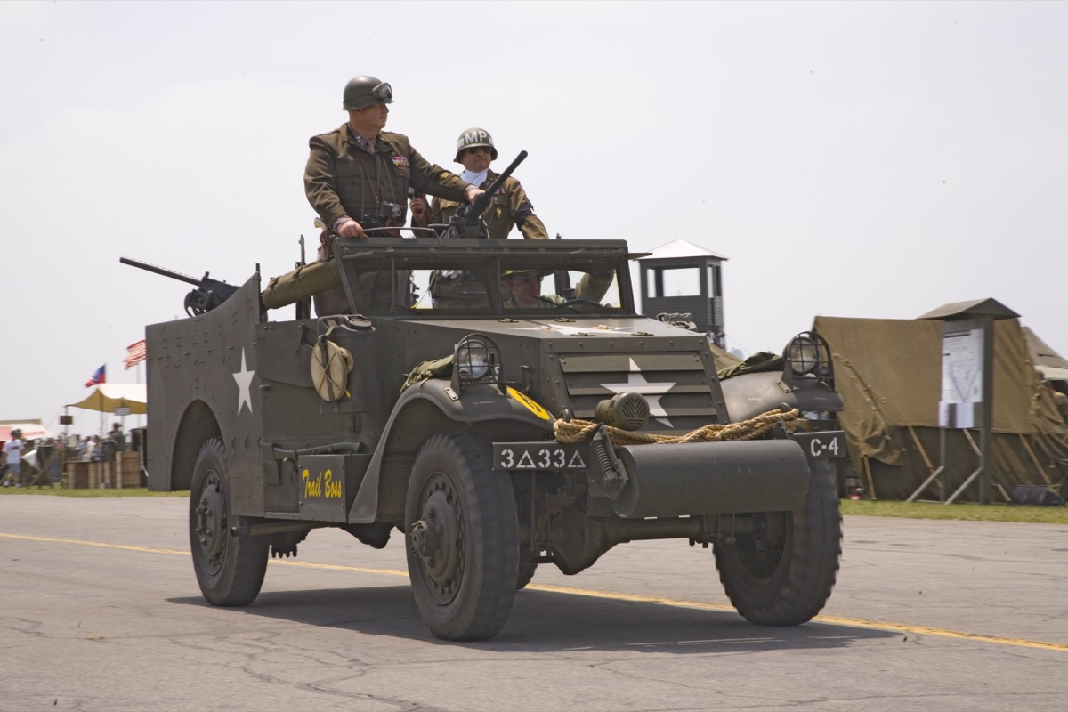 Actor of General George Smith Patton, Jr. stands up in jeep during reenactment parade of World War II in Reading, Pennsylvania