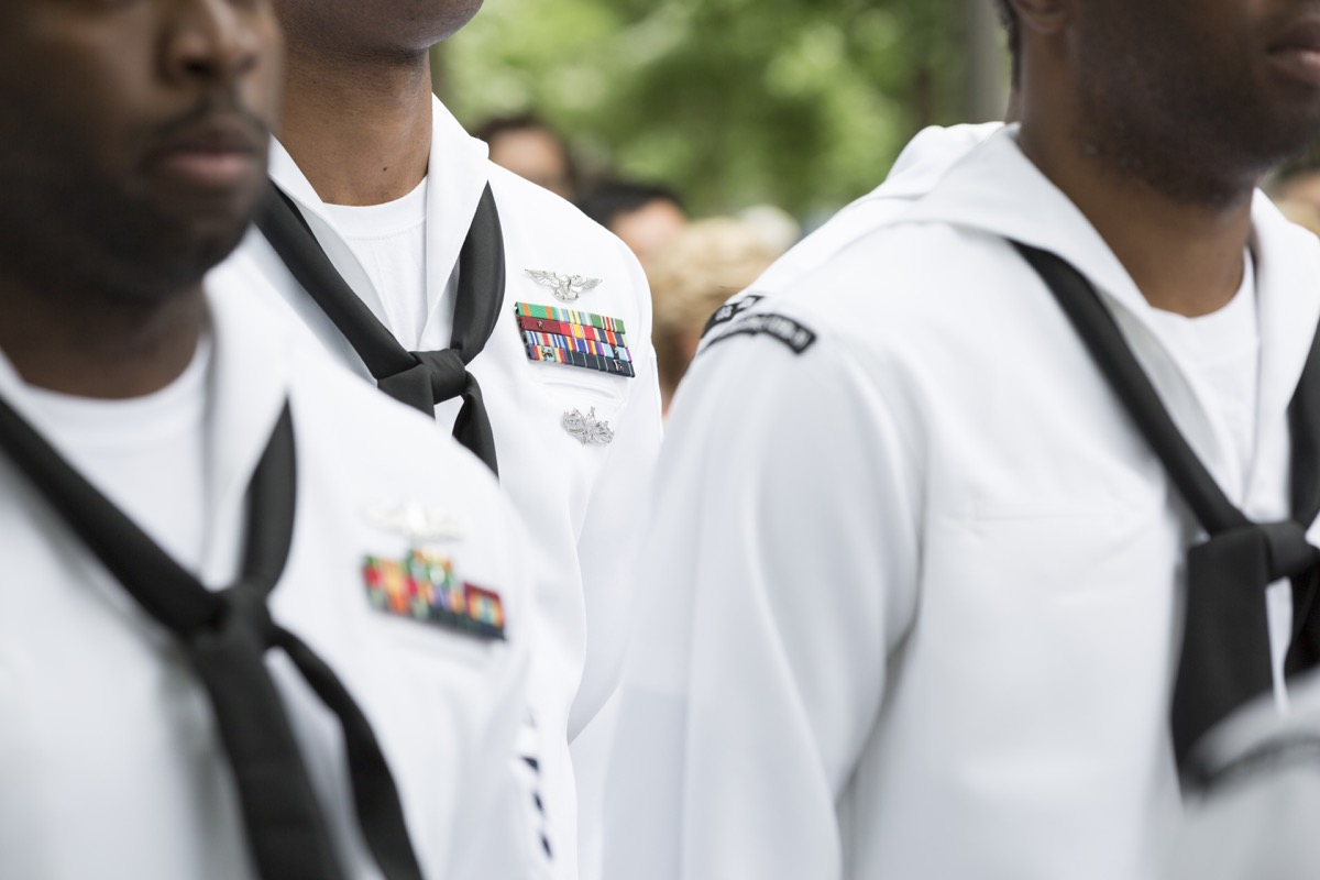 Close up of military medals, ribbons, and neck scarves worn by U.S. Navy personnel at the re-enlistment and promotion ceremony on National September 11 Memorial site