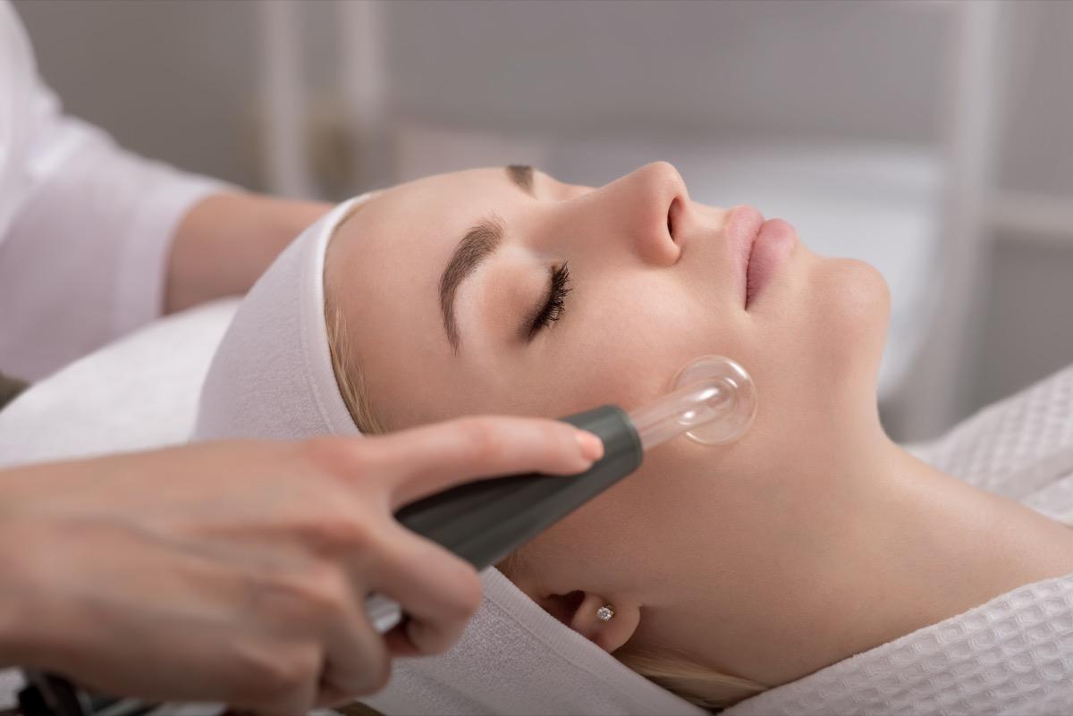 woman receiving a vacuum facial