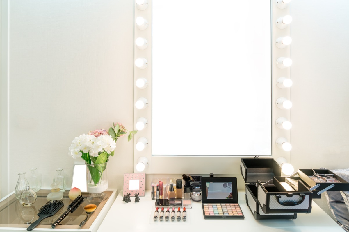 Modern closet room with make-up vanity table, mirror and cosmetics product in flat style house