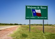 Welcome to Texas sign on side of highway