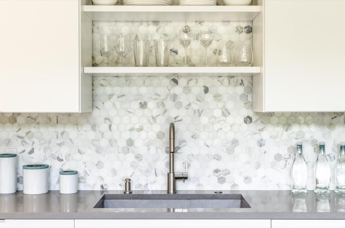White and gray kitchen with octagonal backsplash