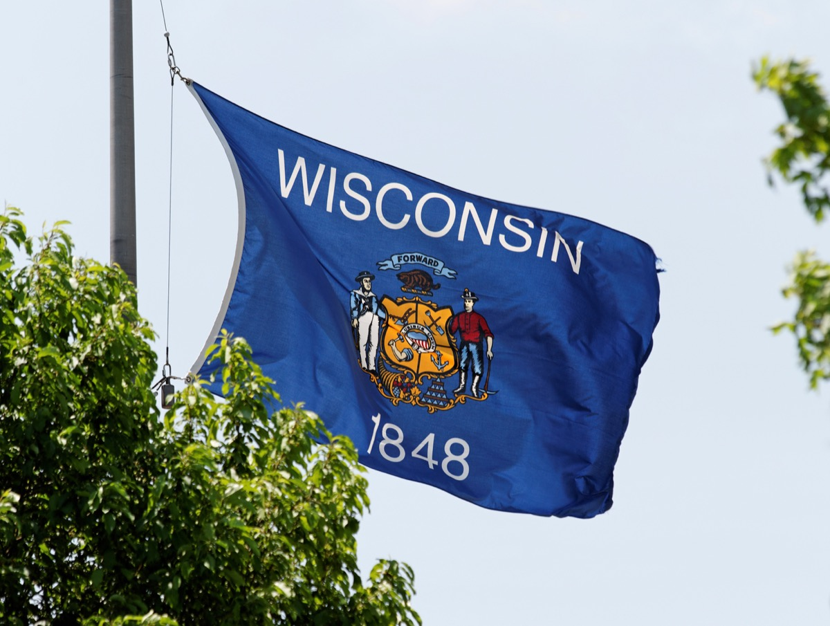 The Wisconsin state flag waving in the wind state flag facts