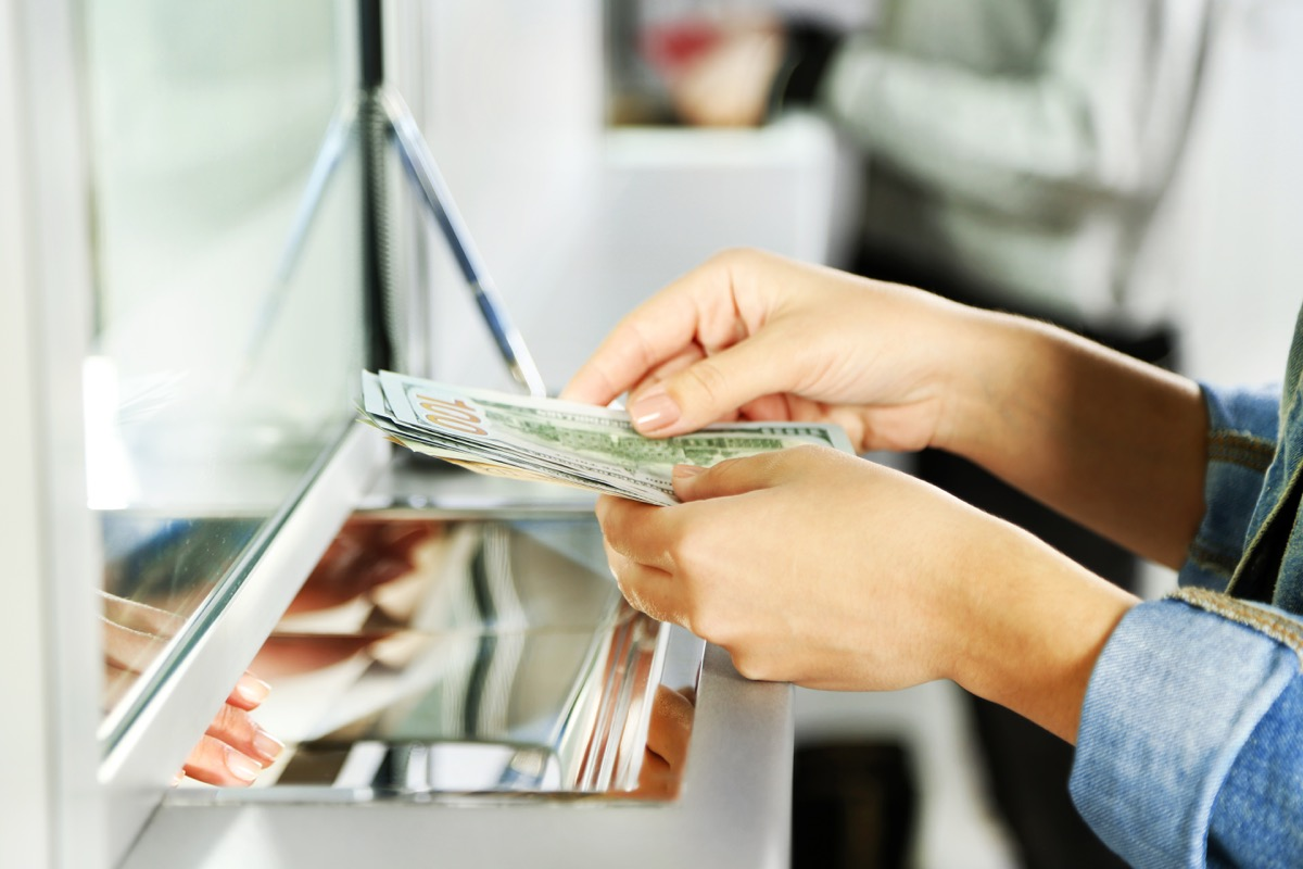 Woman depositing money at the bank