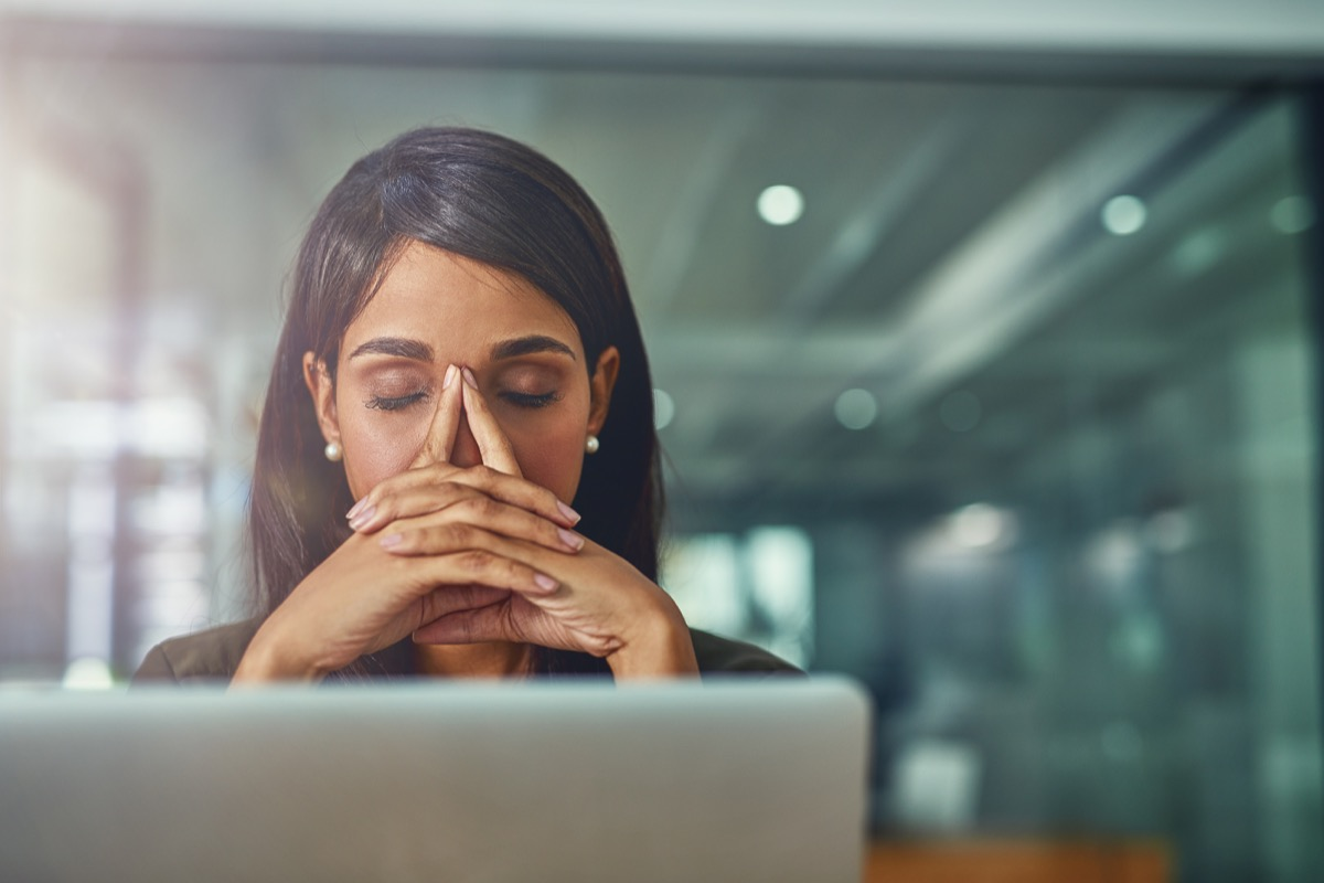 woman feeling drained at desk job