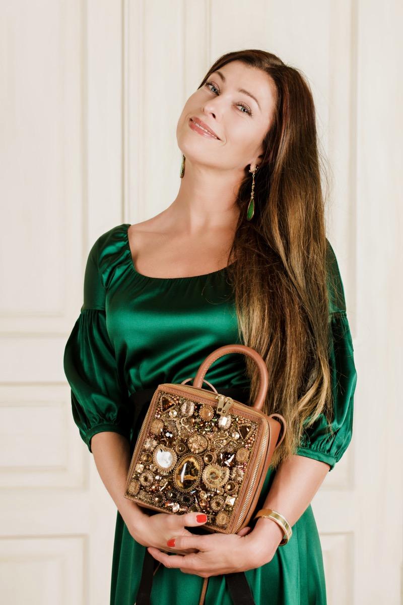 Woman holding a jeweled bag
