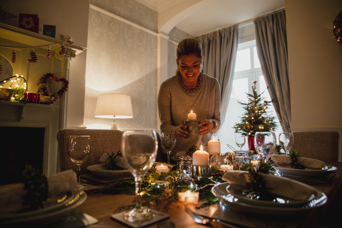 Woman setting the table with festive decorations