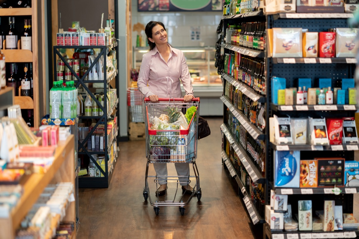 woman shopping near the end cap at store