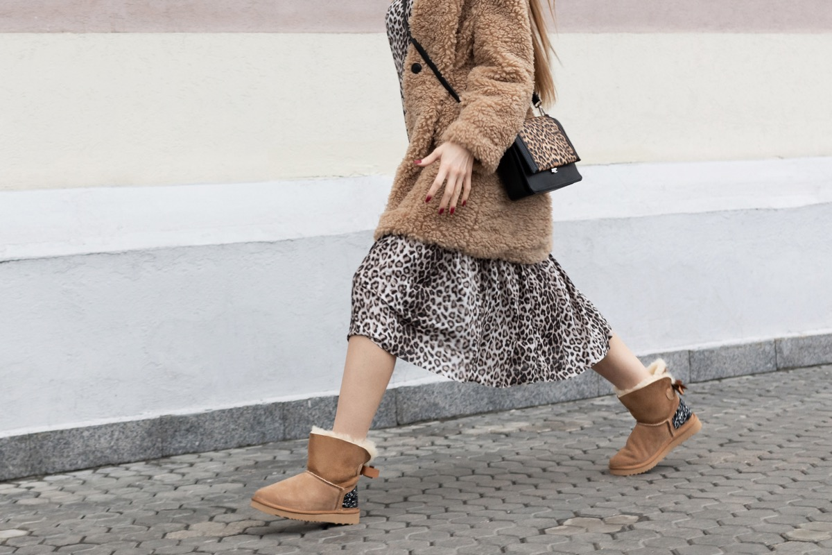 Woman walking wearing leopard print and uggs
