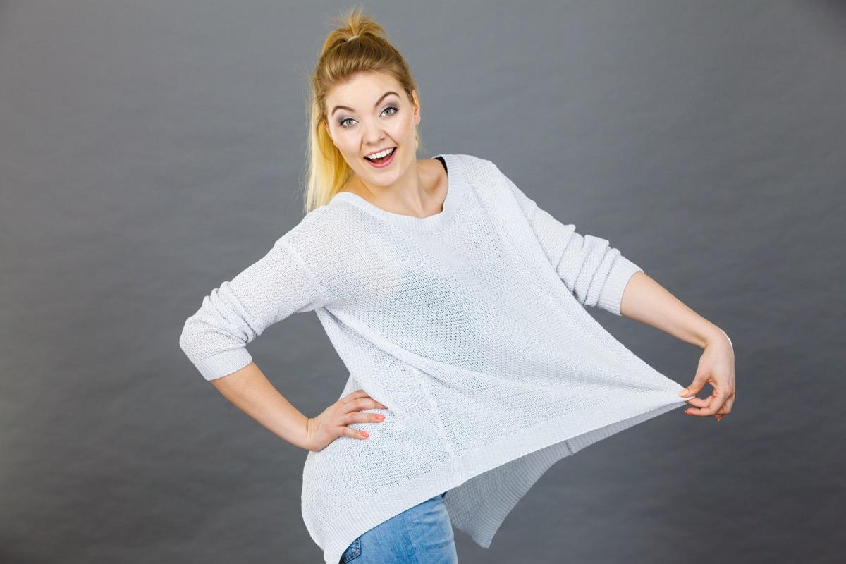 Woman wearing loose fitting big white shirt