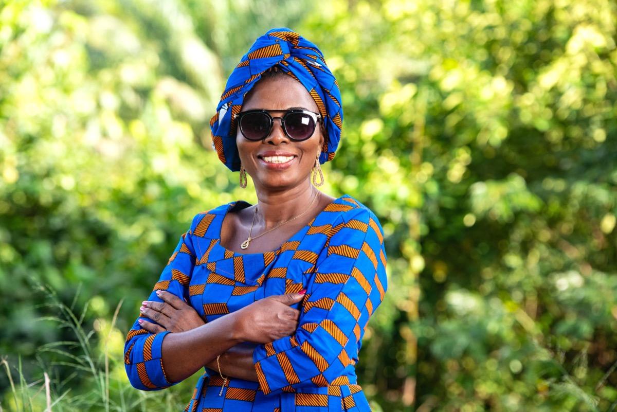 Woman smiling wearing sunglasses