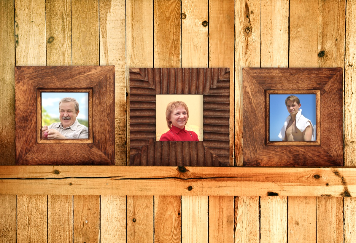 Wooden picture frames with family photographs in them