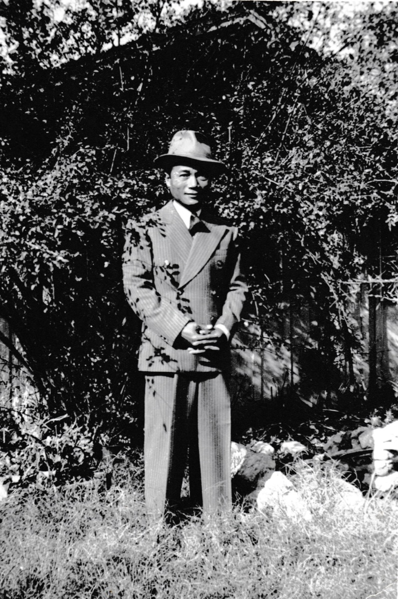 Marshall Tuason a Filipino immigrant in the United States in 1941 in a pin stripe suit.