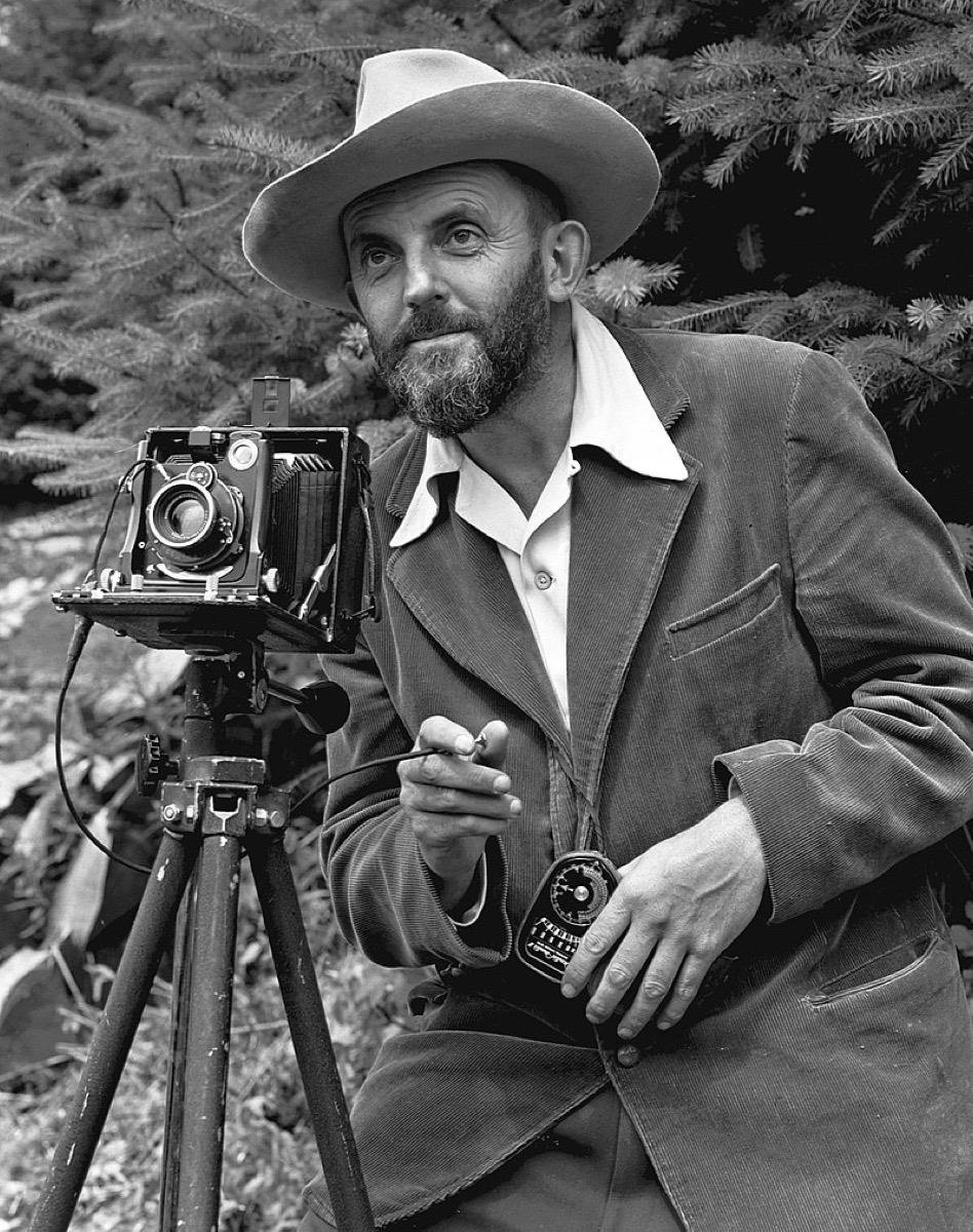 Photographic portrait of nature photographer Ansel Adams — which first appeared in the 1950 Yosemite Field School yearbook. The camera is probably a Zeiss Ikon Universal Juwel.