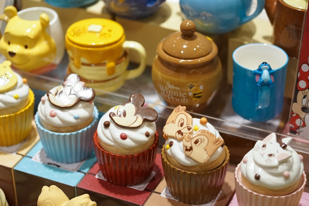 Bangkok, Thailand - Feb 17, 2019 : A photo of Disney Merchandises in stores with selective focus on Mickey Mouse ceramic cupcake. On the right is Chips & Dales the chipmunks. - Image