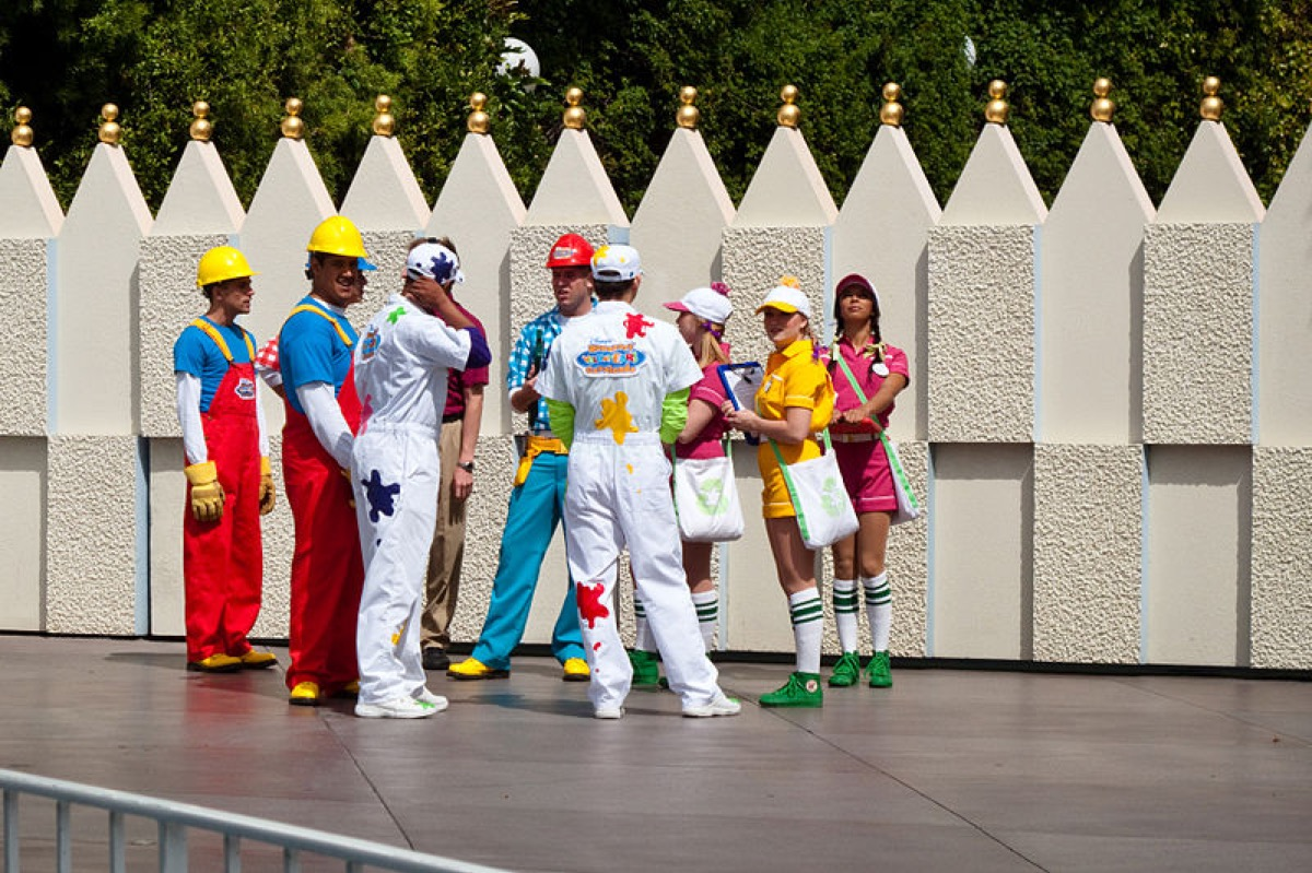 """The back of the guys outfits say """"Honorary VoluntEARs Cavalcade"""" so I'm assuming they were prepping for the parade that was starting in a bit. I just love the outfits."""