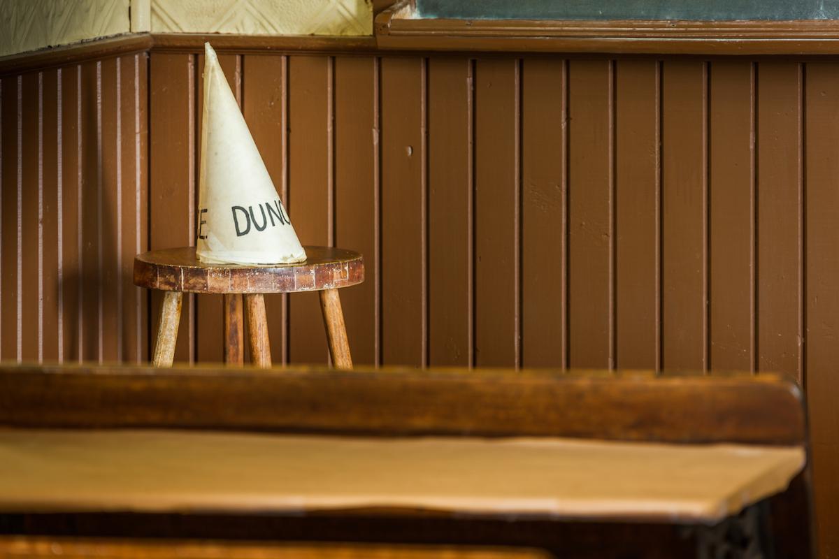 Dunce cap on stool
