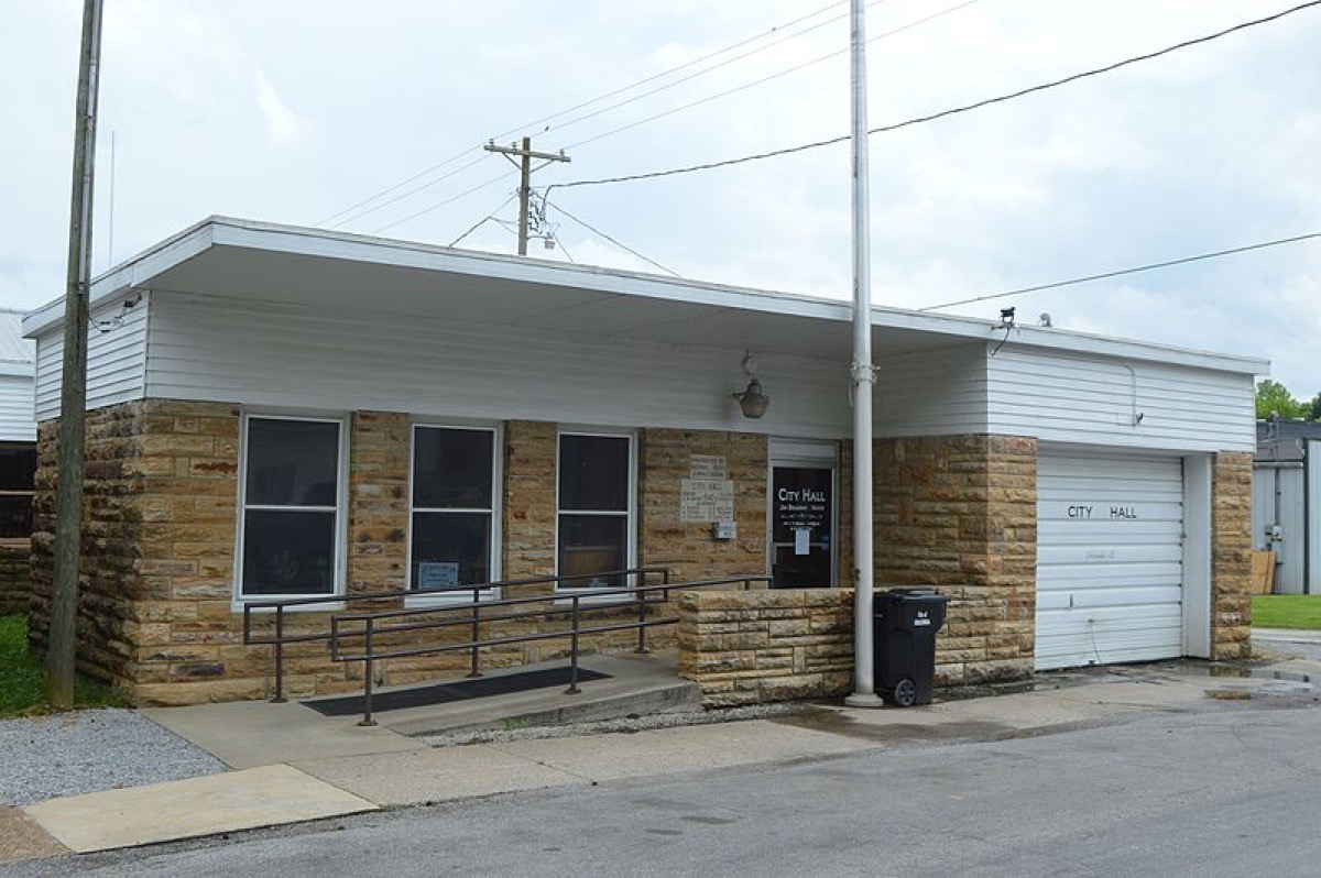 Front of the Golconda city hall, located at 118 Monroe Street in Golconda, Illinois, United States. According to the plaque, it was built by the National Youth Administration in 1940.