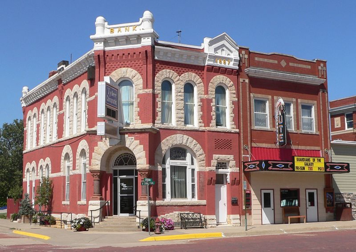 First National Bank building (left) and Ute Theater (right), located at northwest corner of Jefferson and Commercial Streets in Mankato, Kansas; seen from the southeast.