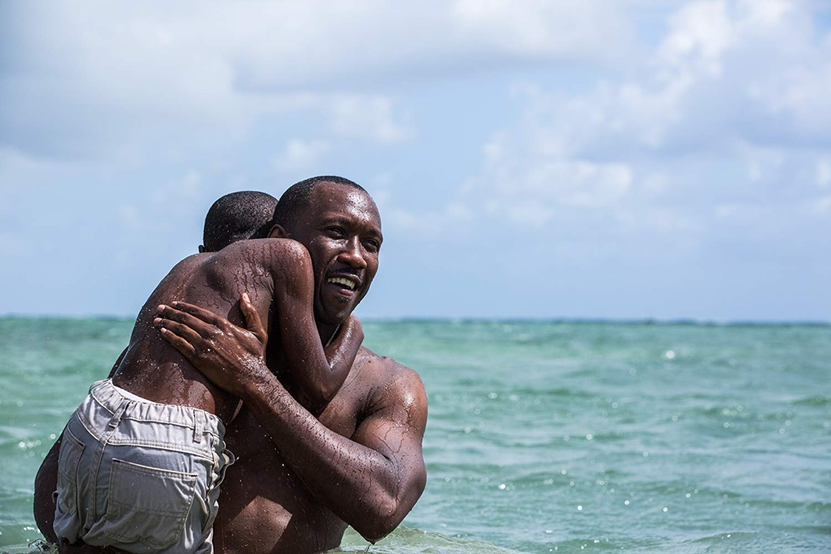 Mahershala Ali and Alex R. Hibbert in Moonlight (2016) movies on rotten tomatoes with the highest ratings