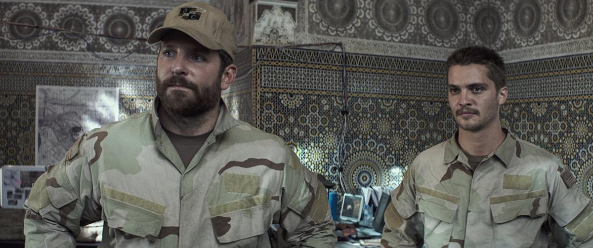 Bradley Cooper and Luke Grimes in American Sniper (2014)
