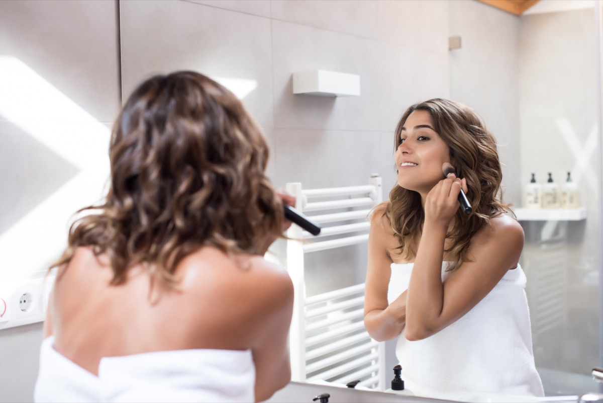 Woman applying foundation makeup