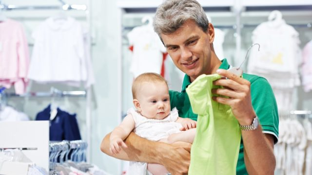A Baby and Father Shopping for Clothes {Save Money on Kids' Clothes}