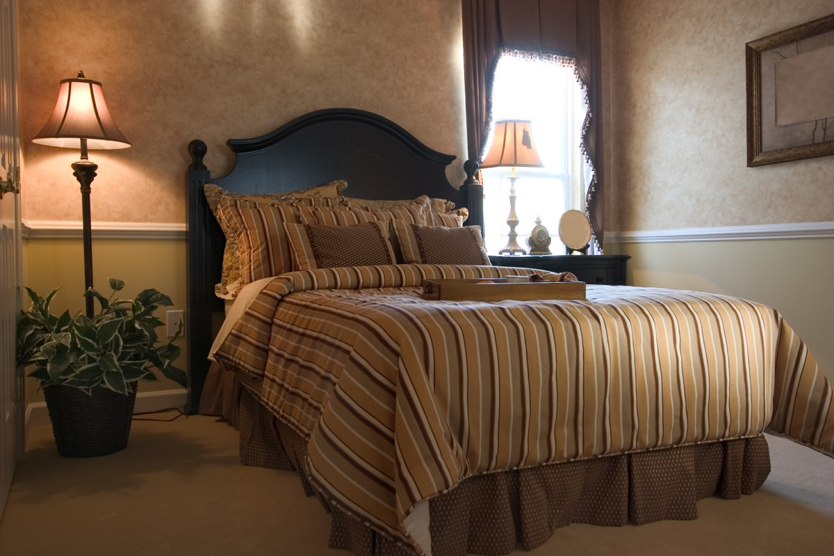 brown bedroom with bedskirt