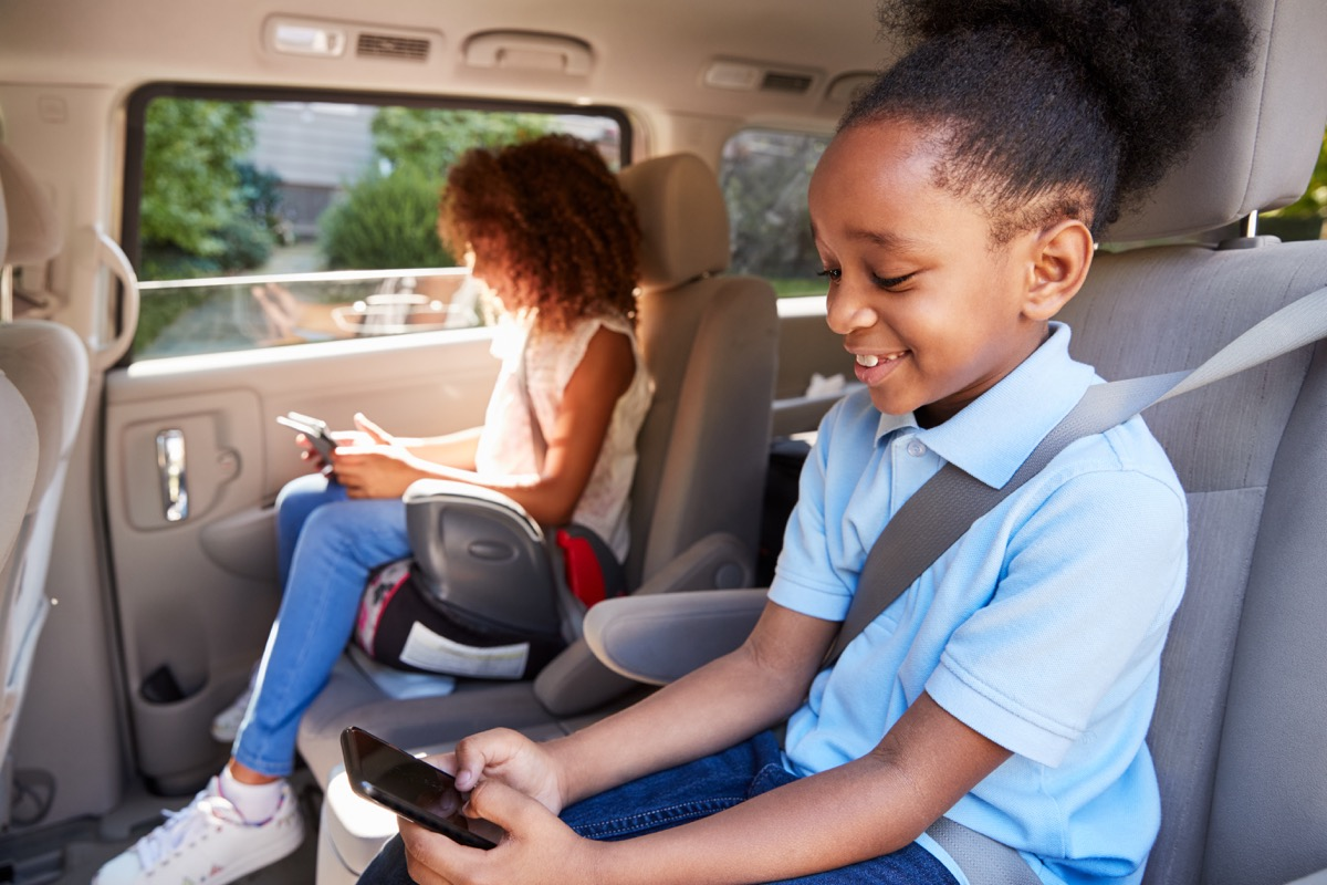 Children Using Digital Devices On Car Journey, ways parenting has changed.