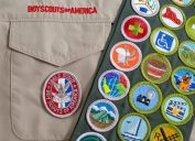 SAINT LOUIS, UNITED STATES - OCTOBER 16, 2017: Eagle patch and merit badge sash on Boy Scouts of America (BSA) uniform - Image