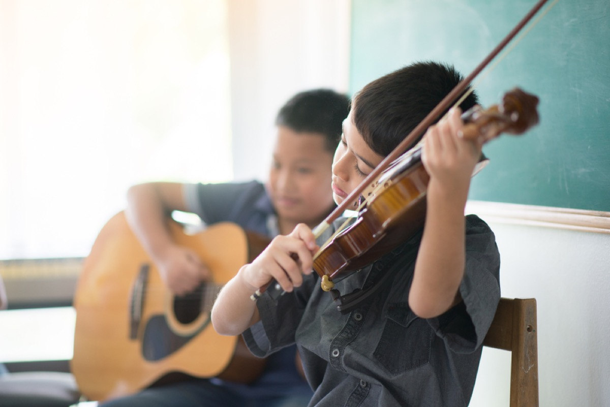 two young boys playing violin and guitar, bad parenting advice