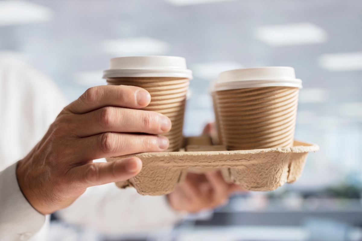 Businessman Bringing Coffees to His Coworkers Small Acts of Kindness