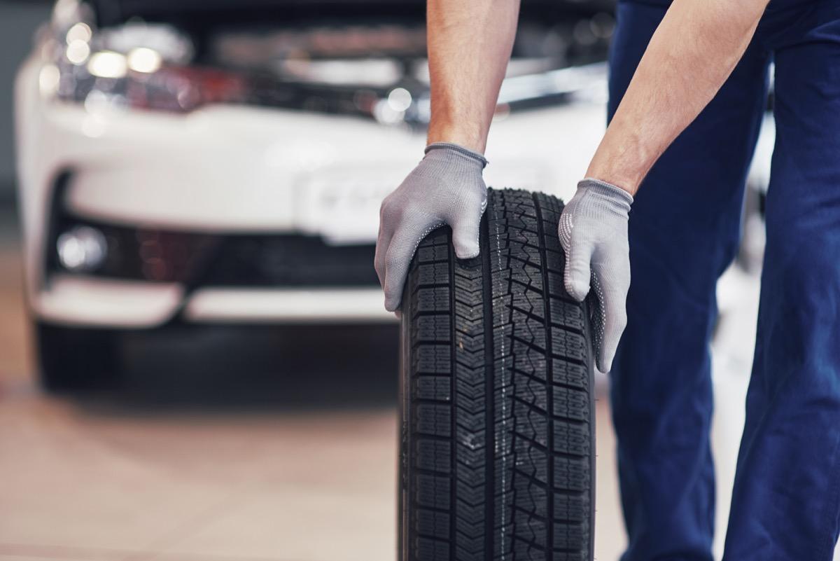 Man Holding a Car Tire {Never Buy on Craigslist}